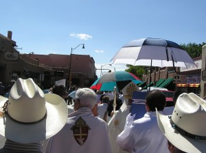 The procession from where I was (the archbishop was also in the rear, so I guess it wasn't such a bad place to be... (that's him under the blue and white umbrella)