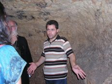 Guide explaining catacomb under Church of St Mary Om al-Zenar