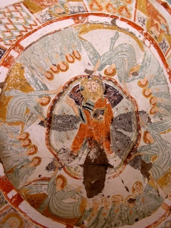 Old fresco on the church carved in the canyon