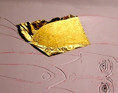 After pulling the paper off, the gold will stick to the size, not the gesso