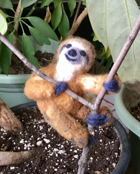 Sloth on a stick in potted plant