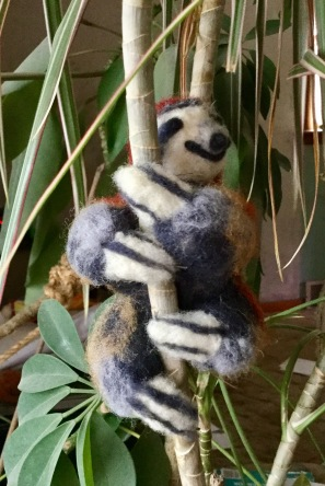 Sloth with wires on plant
